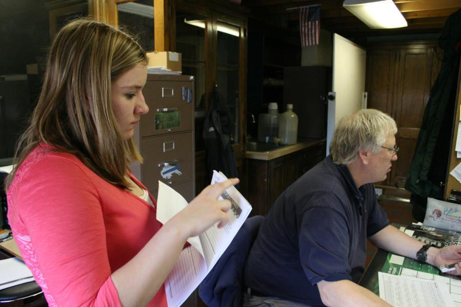 Sierra Gunnel collecting bball scores from Bob Howard