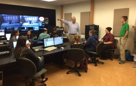 Journalism professor Ray Eckness works with Montana high school students as they assemble a live broadcast on April 14.