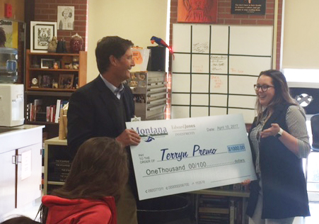 MNA Executive Director Jim Rickman presents Terryn Premo with a $1,000 scholarship.