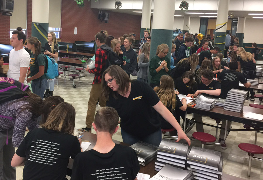 The annual yearbook release party at C M. Russell High School in Great Falls took place on May 18, complete with a live jazz band, homemade cookies and hundreds of customers.