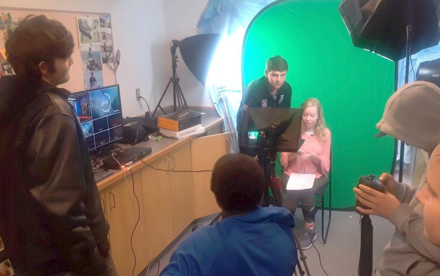 Michael McKay directs Corvallis High School's live stream of the morning news.