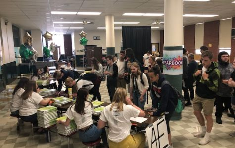 The C.M. Russell High School Russellog staff held a distribution party -- complete with a live jazz band -- in the school cafeteria on May 16. This year's 300+ page book sold out quickly.